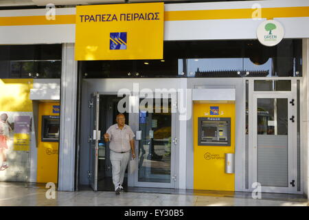 Athens, Greece. 20th July, 2015. A customer leaves a Piraeus Bank branch. Greek banks have re-opened three weeks - Stock Photo