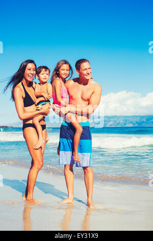 Portrait of Young Happy Family Having Fun at the Beach Outdoors - Stock Photo
