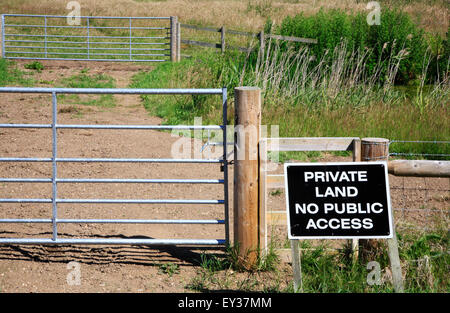Private Land No Public Access sign by grazing meadows in the Norfolk Broads. - Stock Photo