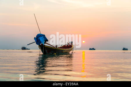 Longtail boat, South China Sea at sunset with boats, Gulf of Thailand, Koh Tao island, Thailand - Stock Photo