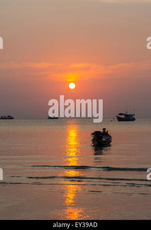 South China Sea at sunset with boats, Gulf of Thailand, Koh Tao island, Thailand - Stock Photo