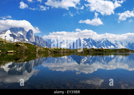Mont Blanc massif reflected in Lac de Chésserys, Aiguilles de Chamonix on the left, Chamonix, France - Stock Photo