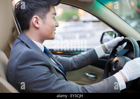 Chauffeur driving car - Stock Photo