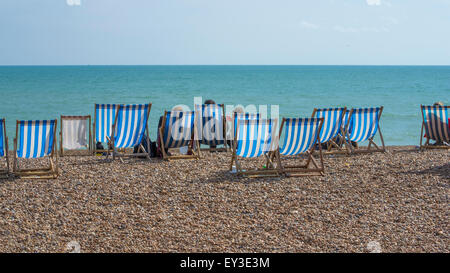 a number of deck-chairs on Bright Beach. - Stock Photo