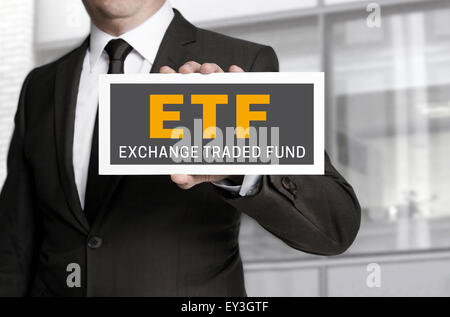 ETF sign is held by businessman background. - Stock Photo