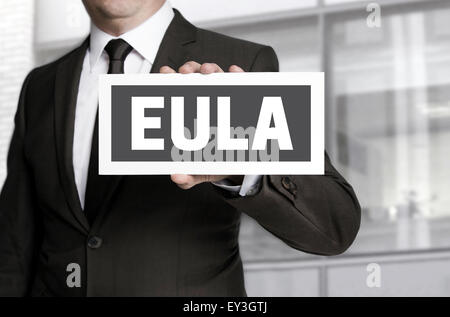 EULA sign is held by businessman background. - Stock Photo