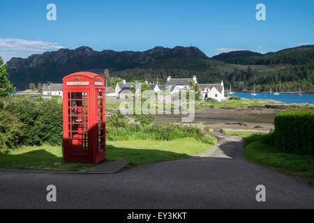 A telephone box in the village of Plockton on the shores of Loch Carron in the Highlands of Scotland. - Stock Photo