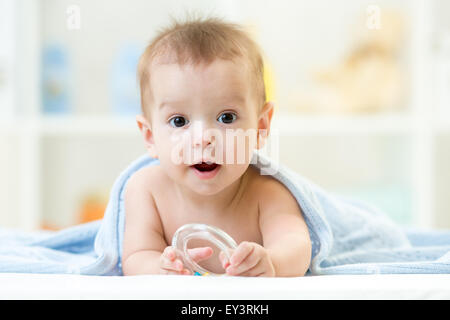 baby with teether wrapped blanket indoor - Stock Photo