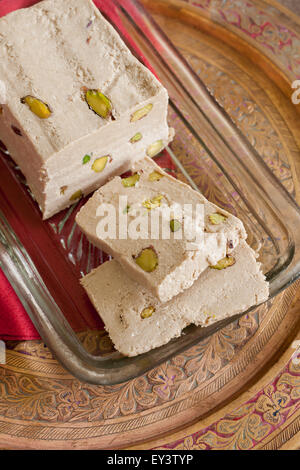 Halvah or Halva a sweet confection made with tahini sesame paste and pistachio nuts popular throughout the Middle - Stock Photo