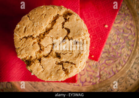 Ginger and treacle or molasses biscuits in a stack shot with low key lighting and shallow focus - Stock Photo