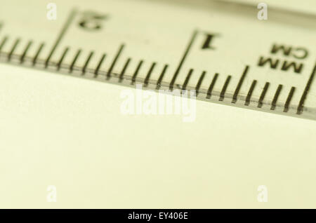 transparent ruler macro on paper background - Stock Photo