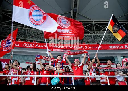 Chinese fans of German Bundesliga soccer club FC Bayern Munich cheer for the team before its pre-season friendly - Stock Photo