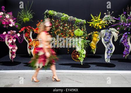 Blurred out of focus figures moving in front Still life floral arrangement, floral, arrangement, flower, nature, - Stock Photo
