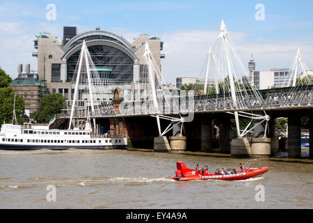 Charing Cross station and bridge seen from across the River Thames, London England UK - Stock Photo