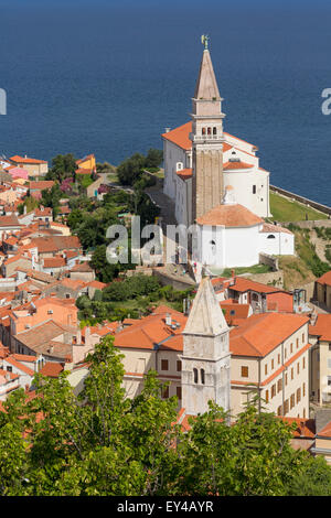 Piran, Primorska, Slovenia. Overall view of the town and of St. George's cathedral from the Town Walls. - Stock Photo