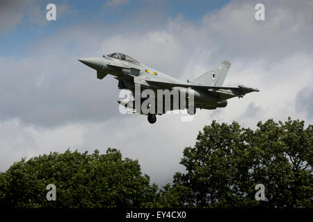A Royal Air Force Typhoon figher from 11 Squadron on final approach at RAF Coningsby Lincolnshire, with the units - Stock Photo