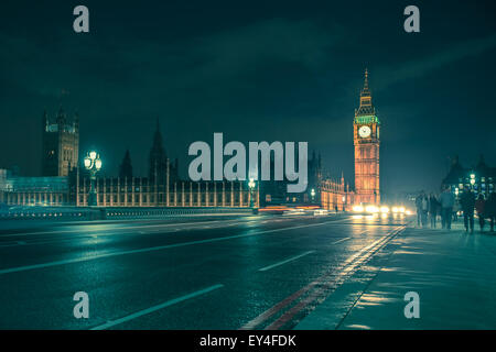 London, United Kingdom - October 8, 2014: Night view of Big Ben across with Westminster Bridge on a damp night with - Stock Photo