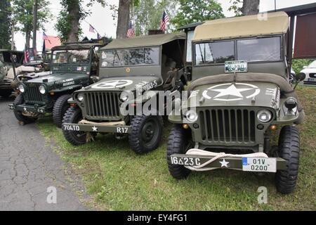 World War II US Army Jeeps on display at vilage near germany border - Stock Photo
