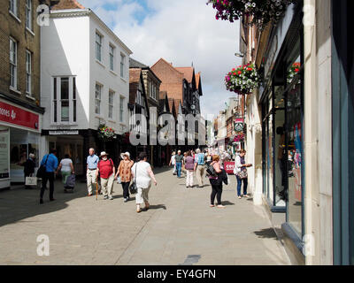 The High Street in Winchester, Hampshire on  quiet Tuesday morning in July - the view loeking west up the street - Stock Photo