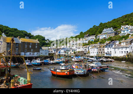 The harbour at low tide in the fishing village of Polperro, Cornwall, England, UK - Stock Photo