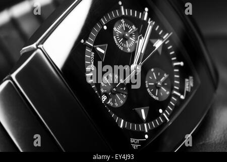 Luxury mens chronograph watch made of black high-tech ceramics. Close-up studio photo with selective focus - Stock Photo