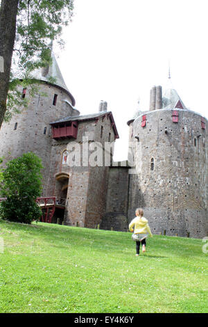 Young girl running towards castle or Castell Coch, Cardiff, South Wales, UK - Stock Photo