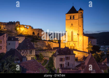 Twilight over medieval town of Saint-Cirq-Lapopie, Vallee du Lot, Midi-Pyrenees, France - Stock Photo