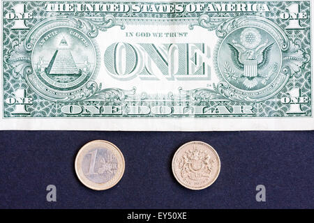 The big three currencies, American dollar, British Pound and the Euro, laid out, one banknote and two coins, £ $ - Stock Photo