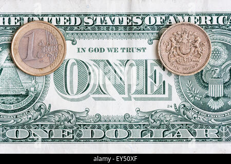 The big three currencies, American dollar, British Pound and the Euro, laid out, one banknote and two coins on top, - Stock Photo