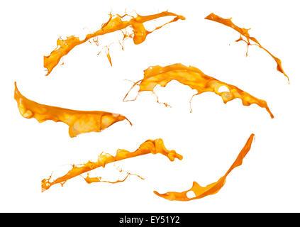 perfect splashes of orange paint isolated on white background