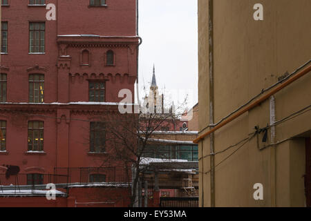 Old buildings of Moscow in wintertime. Tall building of the Ministry of Foreign Affairs of Russia in the background - Stock Photo