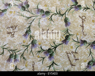 Cloth with thistles and Scottish towns listed - Stock Photo