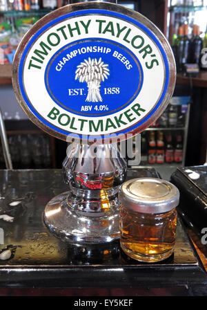 A pump and sample of Timothy Taylor Boltmaker Bitter, in a bar, Yorkshire, England, UK - Stock Photo