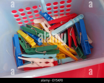 Bright Washday clothes pegs for washing line, in red,blue, yellow,green basket - Stock Photo