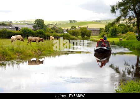 Lancaster Canal Trust trip boat near Crooklands on 'Northern Reaches' of Lancaster Canal, Cumbria, England - Stock Photo