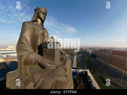 Statue of St Barbara at the roof of the Academy of Mines and Metallurgy Building, AGH, Krakow, Poland - Stock Photo