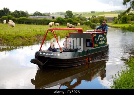 Lancaster Canal Trust trip boat on Northern Reaches of Lancaster Canal, near Crooklands, Cumbria - Stock Photo