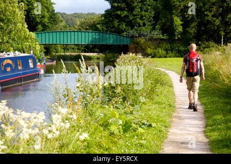walking on Lancaster Canal north of Carnforth, Lancashire - Stock Photo