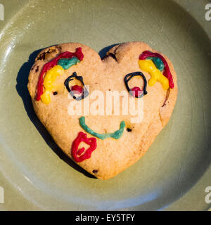 Heart shaped home-made biscuit for a children's party - Stock Photo