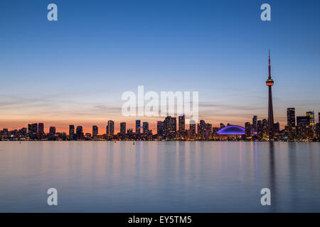 A view of buildings West of Downtown at dusk from Lake Ontario with copy space above or below the buildings - Stock Photo