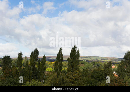 View north-west from Bolton town centre towards Smithills Moor and the distant Winter Hill TV mast. - Stock Photo