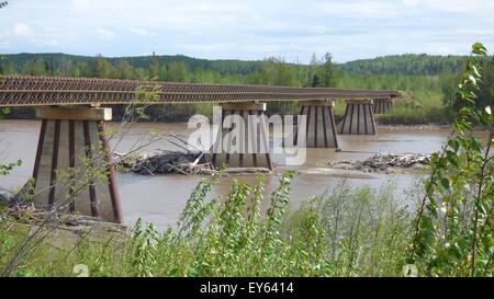 Narrow, single lane, wooden decked bridge over the Nelson River in British Columbia, just north of Fort Nelson. - Stock Photo