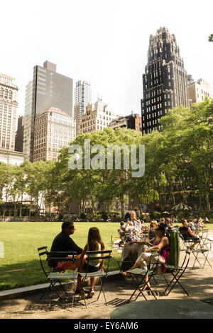 The Great Lawn, Public Bryant Park on a hot day, New York Public Library, New York City, Manhattan. USA - Stock Photo