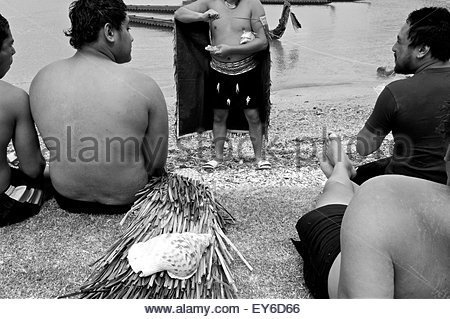 Members of a waka (traditional Maori canoe) crew participating in Waitangi Day annual commemorations on Waitangi - Stock Photo