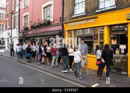 People queuing up outside the popular Breakfast Club cafe restaurant, D'arblay St, Soho, London UK - Stock Photo