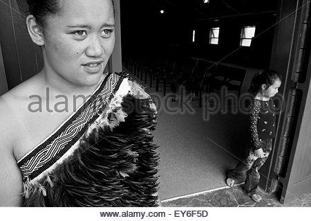 Two Maori girls at the entrance of Tamatea Marae in Motuti, Northland, North Island, New Zealand - Stock Photo