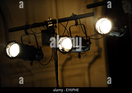 Three black spotlights turned on during an event - Stock Photo