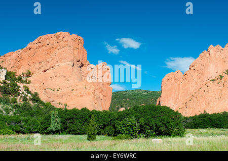 Early morning sun on the North and South Gateway formations in the Garden of the Gods. The Garden of the Gods is - Stock Photo