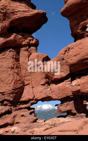 One of many red sandstone formations in the Garden of the Gods, the Siamese Twins rock formation with a snow covered - Stock Photo