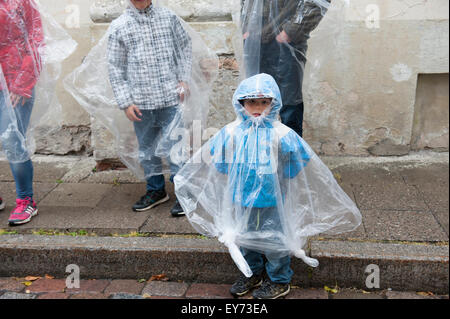 A rainy day in Tallinn, Estonia's Old Town, with ponchos for sale in the souvenir shops. - Stock Photo